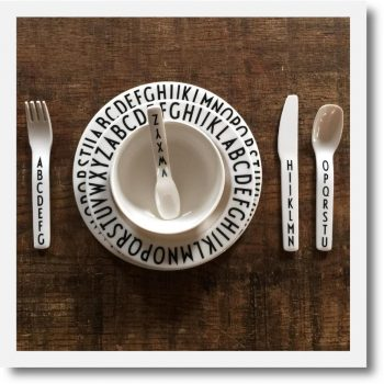 Design Letters Alphabet Melamine Dinner set arranged on wooden table