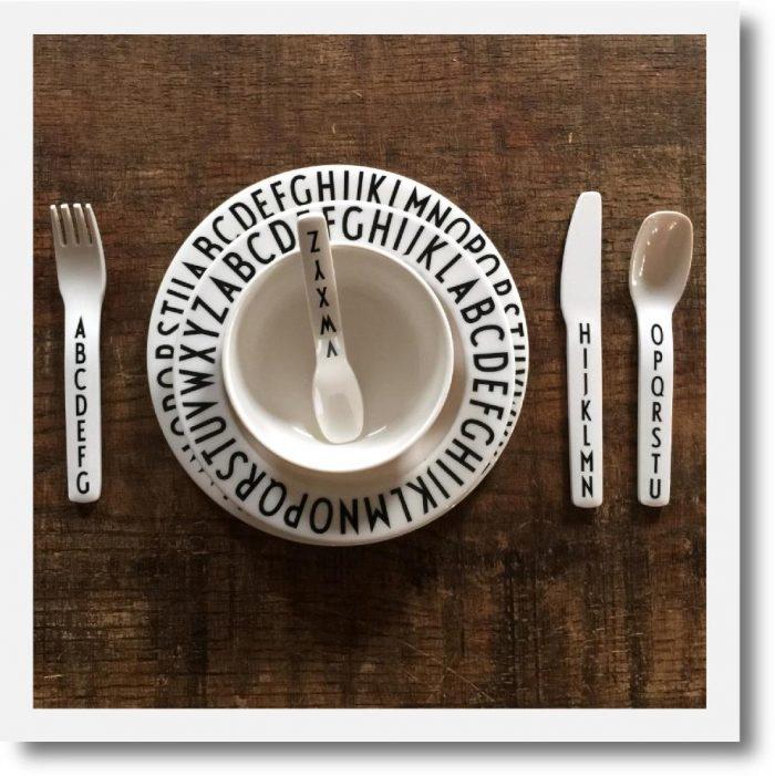 Design Letters Alphabet Melamine Dinner set arranged on wooden table