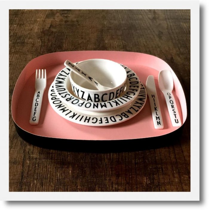 Design Letters Luxury Kids Dinner Set Pink. Monochrome 4 piece set on a pink metal tray.